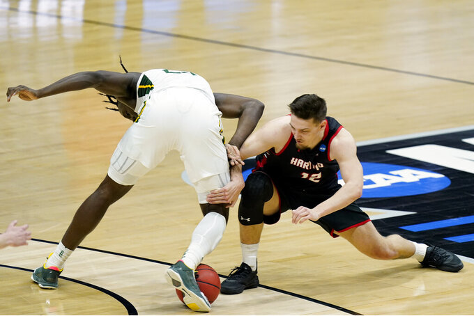 Baylor's Jonathan Tchamwa Tchatchoua, left, and Hartford's Miroslav Stafl (12) battle for the ball during the first half of a college basketball game in the first round of the NCAA tournament at Lucas Oil Stadium in Indianapolis Friday, March 19, 2021, in Indianapolis, Tenn. (AP Photo/Mark Humphrey)