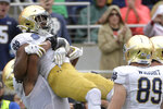 Notre Dame running back Jafar Armstrong is congratulated by teammates after rushing for a 1-yard touchdown during the first half of the Camping World Bowl NCAA college football game against Iowa State Saturday, Dec. 28, 2019, in Orlando, Fla. (AP Photo/Phelan M. Ebenhack)