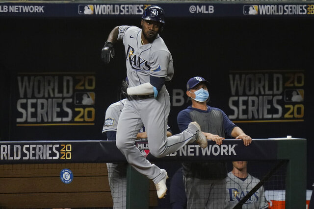 Tampa Bay Rays' Randy Arozarena celebrates a home run during the first inning in Game 6 of the baseball World Series against the Los Angeles Dodgers Tuesday, Oct. 27, 2020, in Arlington, Texas. (AP Photo/Eric Gay)