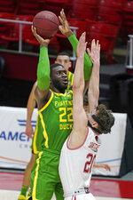 Oregon center Franck Kepnang (22) shoots as Utah forward Mikael Jantunen (20) defends during the first half of an NCAA college basketball game Saturday, Jan. 9, 2021, in Salt Lake City. (AP Photo/Rick Bowmer)