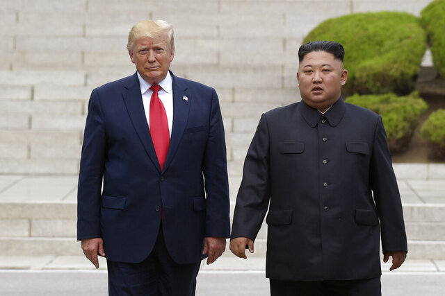 "FILE - In this June 30, 2019, file photo, President Donald Trump, left, meets with North Korean leader Kim Jong Un at the North Korean side of the border at the village of Panmunjom in Demilitarized Zone. Journalist Bob Woodward's book ""Rage,"