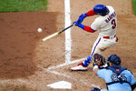 Philadelphia Phillies' Bryce Harper hits a two-run home run off Toronto Blue Jays pitcher Robbie Ray during the fifth inning of the first baseball game in a doubleheader, Friday, Sept. 18, 2020, in Philadelphia. (AP Photo/Matt Slocum)