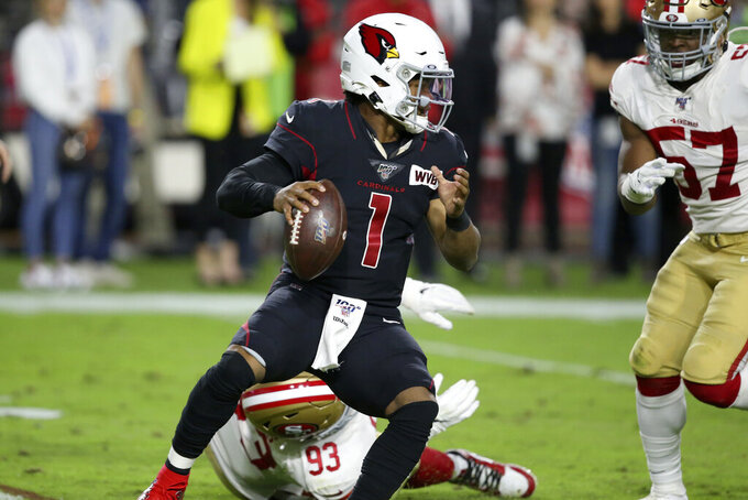 Arizona Cardinals quarterback Kyler Murray (1) avoids the hit of San Francisco 49ers defensive tackle D.J. Jones (93) during the first half of an NFL football game, Thursday, Oct. 31, 2019, in Glendale, Ariz. (AP Photo/Ross D. Franklin)