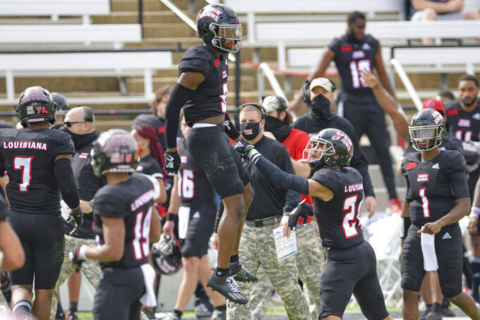 Louisiana-Lafayette safety Percy Butler (9) celebrates an interception next to Louisiana-Lafayette head coach Billy Napier during an NCAA college football game against South Alabama in Lafayette, La., Saturday, Nov. 14, 2020. (AP Photo/Matthew Hinton)