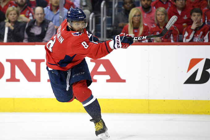 """FILE - In this April 13, 2019, file photo, Washington Capitals left wing Alex Ovechkin (8), of Russia, follows through on a shot during the second period of Game 2 of an NHL hockey first-round playoff series against the Carolina Hurricanes, in Washington. Washington's Alex Ovechkin and Boston's David Pastrnak share the Maurice """"Rocket"""" Richard Trophy the league announced Thursday, May 28, 2020. (AP Photo/Nick Wass, File)"""