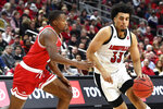 Louisville forward Jordan Nwora (33) tries to get around Miami (Ohio) guard Myja White (11) during the second half of an NCAA college basketball game in Louisville, Ky., Wednesday, Dec. 18, 2019. Louisville won 70-46. (AP Photo/Timothy D. Easley)