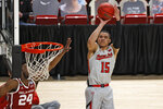 Texas Tech's Kevin McCullar (15) shoots during the first half of an NCAA college basketball game against Oklahoma, Monday, Feb. 1, 2021, in Lubbock, Texas. (AP Photo/Brad Tollefson)