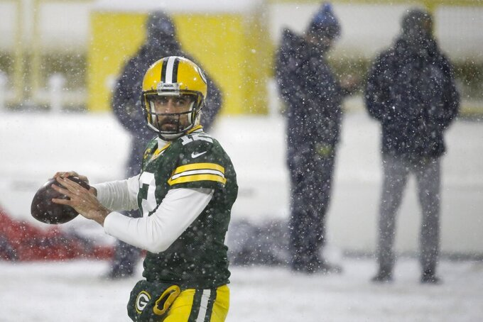 Green Bay Packers' Aaron Rodgers warms up before an NFL football game Sunday, Dec. 27, 2020, in Green Bay, Wis. (AP Photo/Mike Roemer)