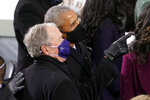 FILE - In this Jan. 20, 2021, file photo former President Barack Obama and former President George W. Bush look up to the crowd as they arrive for the 59th Presidential Inauguration at the U.S. Capitol for President-elect Joe Biden in Washington. (AP Photo/Andrew Harnik, File)