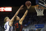 San Diego State guard Malachi Flynn (22) lays the ball up in front Nevada forward Zane Meeks (15) during the first half of an NCAA college basketball game played at Lawlor Events Center in Reno, Nev., Saturday, Feb. 29, 2020. (AP P /Tom R. Smedes)