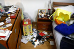 This photo shows a bedroom in the home of Venezuelan lawyer Roberto Marrero that was left in disarray by masked security forces, in Caracas, Venezuela, Thursday, March 21, 2019. Marrero, a key aide to opposition leader Juan Guaido, was taken away by intelligence agents in an overnight operation on his home early Thursday. (AP Photo/Ariana Cubillos)