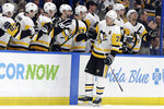 Pittsburgh Penguins center Evgeni Malkin (71) celebrates with the bench after his goal against the Tampa Bay Lightning during the second period of an NHL hockey game Thursday, Feb. 6, 2020, in Tampa, Fla. (AP Photo/Chris O'Meara)