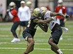 New Orleans Saints wide receiver Lil'Jordan Humphrey (84) blocked by Chauncey Gardner-Johnson (22) during NFL football rookie camp at the team's headquarters in Metairie, La., Saturday, May 11, 2019. (Michael DeMocker/The Times-Picayune via AP)