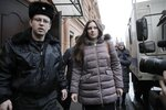 Alla Ilyina, who broke out of the hospital on Feb. 7 after learning that she would have to spend 14 days in isolation instead of the 24 hours doctors promised her, is escorted by a bailiffs form a court after a session in St.Petersburg, Russia, Monday, Feb. 17, 2020.A woman who escaped from a hospital in St. Petersburg, where she was being kept in isolation for possible inflection by the new coronavirus, was ordered by court on Monday to return back to the quarantine for at least two days. (AP Photo/Dmitri Lovetsky)