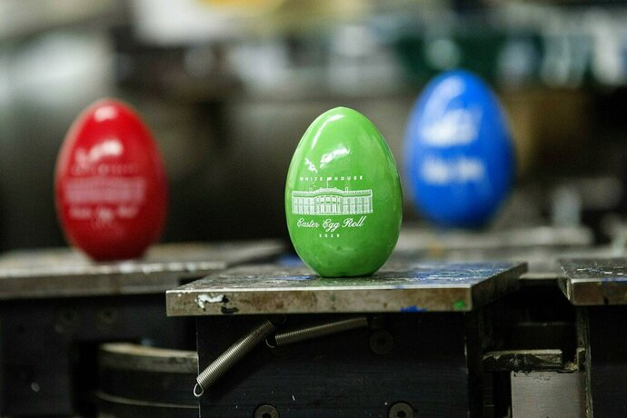 In this March 29, 2019 photo, Easter eggs with the official Seal of the President of the United States sits on display at Maine Wood Concepts in New Vineyard, Maine. The White House Easter Egg Roll will once again feature colorful eggs made in Maine. Maine Wood Concepts has created 100,000 wooden eggs featuring the president and first lady's signatures for the annual event that takes place Monday, April 22, 2019 on the White House lawn.  (Michael G. Seamans/The Central Maine Morning Sentinel via AP)
