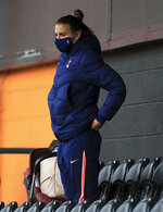 Tottenham Hotspur women's Alex Morgan watches from the stands, during the women's Continental League Cup match between Tottenham Hotspur and London City Lionesses , at the Hive Stadium, in London, Wednesday, Oct. 7, 2020. (Mike Egerton/PA via AP)