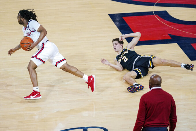Villanova's Collin Gillespie, right, watches as St. John's Posh Alexander, left, drives after stealing the ball from him during the second half of an NCAA college basketball game Wednesday, Feb. 3, 2021, in New York. (AP Photo/Frank Franklin II)