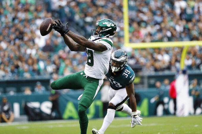 New York Jets' Demaryius Thomas, left, cannot catch a pass against Philadelphia Eagles' Craig James during the second half of an NFL football game, Sunday, Oct. 6, 2019, in Philadelphia. (AP Photo/Michael Perez)