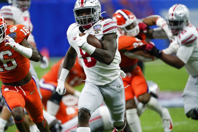 Ohio State running back Trey Sermon runs for a touchdown against Clemson during the first half of the Sugar Bowl NCAA college football game Friday, Jan. 1, 2021, in New Orleans. (AP Photo/John Bazemore)