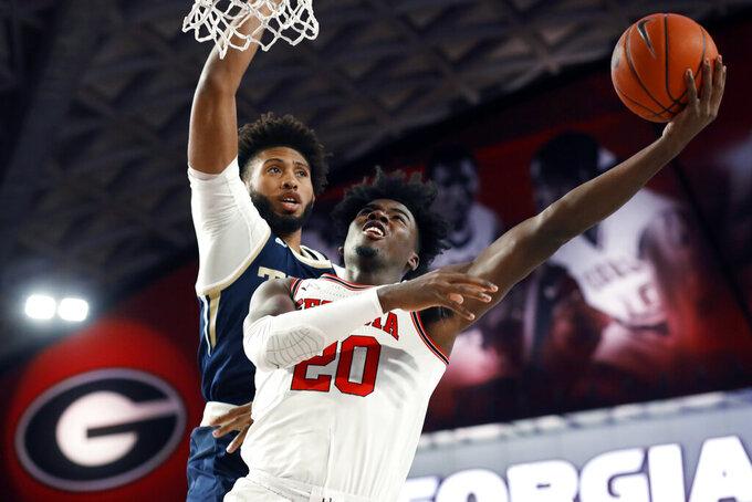 Georgia's Rayshaun Hammonds (20) shoots as Georgia Tech forward James Bnaks III defends during an NCAA college basketball game Wednesday, Nov. 20, 2019, in Athens, Ga. (Joshua L. Jones/Athens Banner-Herald via AP)