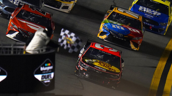 Austin Dillon (3) takes the checkered flag to win the second NASCAR Daytona 500 duel qualifying auto race Friday, Feb. 12, 2021, at the Daytona International Speedway in Daytona Beach, Fla. (AP Photo/Chris O'Meara)