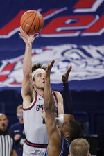 Gonzaga forward Corey Kispert shoots over San Diego forward Josh Parrish during the first half of an NCAA college basketball game in Spokane, Wash., Saturday, Feb. 20, 2021. (AP Photo/Young Kwak)