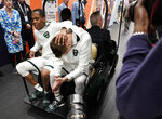 Michigan State's Cassius Winston, left, and Matt McQuaid react as they take a cart back to the locker room after the team's 61-51 loss to Texas Tech in the semifinals of the Final Four NCAA college basketball tournament, Saturday, April 6, 2019, in Minneapolis. (AP Photo/David J. Phillip)