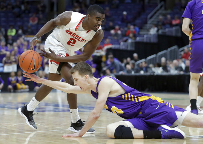 Northern Iowa's Luke McDonnell, bottom, knocks the ball away from Bradley's Luqman Lundy (2) during the second half of an NCAA college basketball game in the championship of the Missouri Valley Conference tournament, Sunday, March 10, 2019, in St. Louis. Bradley won 57-54. (AP Photo/Jeff Roberson)