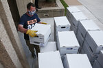 Kris Steele, Executive Director of OCJR and TEEM, carries a box of petitions as Yes on 805 delivers 260,000 gathered signatures to the Secretary of State's office Monday, June 1, 2020, in Oklahoma City, to put sentencing reform on a 2020 ballot. (AP Photo/Sue Ogrocki, Pool)