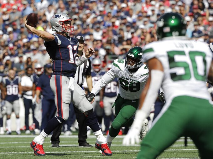 New England Patriots quarterback Tom Brady prepares to throw a touchdown pass to Julian Edelman in the first half of an NFL football game against the New York Jets, Sunday, Sept. 22, 2019, in Foxborough, Mass. (AP Photo/Steven Senne)