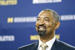 Juwan Howard smiles during his introduction as Michigan's new men's basketball coach, Thursday, May 30, 2019 in Ann Arbor, Mich. The former member of the Fab Five has a five-year contract that will pay him $2 million in his first year. The former Miami Heat assistant coach replaces John Beilein, who left to coach the Cleveland Cavaliers. (AP Photo/Carlos Osorio)