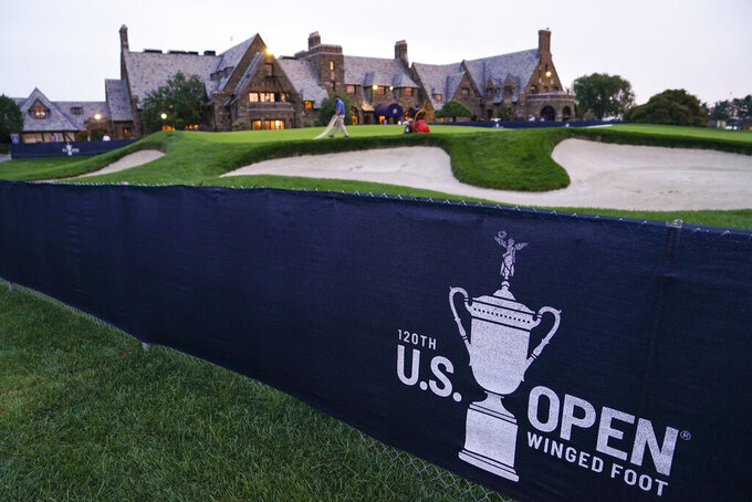 A green is prepared by the grounds crew outside the clubhouse ahead of practices before the U.S. Open Championship golf tournament, Monday, Sept. 14, 2020, at the Winged Foot Golf Club in Mamaroneck, N.Y. (AP Photo/John Minchillo)