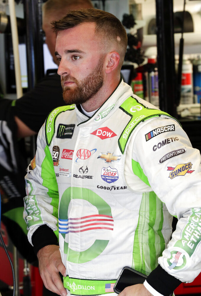 Austin Dillon cools off in his garage at the end of a NASCAR auto race practice at Daytona International Speedway, Thursday, July 4, 2019, in Daytona Beach, Fla. (AP Photo/John Raoux)