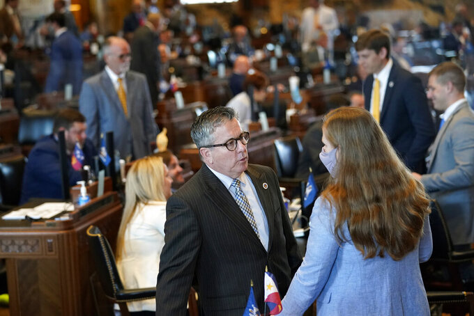 """Rep. Jerome """"Zee"""" Zeringue, R-Houma, chairman of the House Appropriations Committee, talks with a legislative staffer during the opening day of the Louisiana legislative session in Baton Rouge, La., Monday, April 12, 2021. (AP Photo/Gerald Herbert)"""