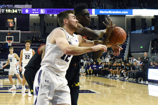 Northwestern guard Pat Spencer (12) and Maryland forward Jalen Smith (25) go for a loose ball during the first half of an NCAA college basketball game, Tuesday, Jan. 21, 2020, in Evanston, Ill. (AP Photo/David Banks)