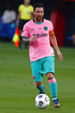 Barcelona's Lionel Messi controls the ball during the pre-season friendly soccer match between Barcelona and Girona at the Johan Cruyff Stadium in Barcelona, Spain, Wednesday, Sept. 16, 2020. (AP Photo/Joan Monfort)