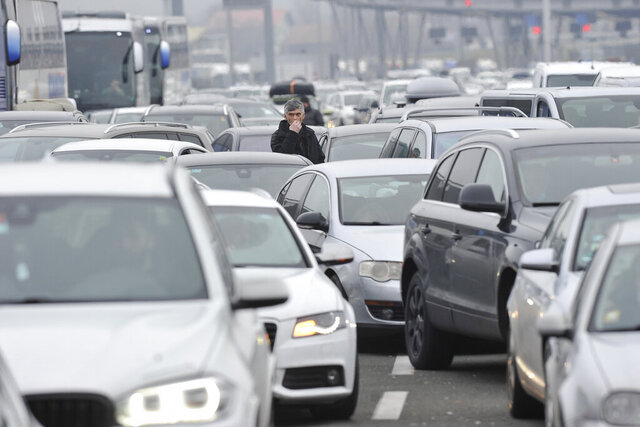 Motorists wait to cross the Croatian border from Slovenia, at Bregana border crossing, western Croatia, Saturday, Dec. 19, 2020. Balkan citizens going home from Western Europe for holidays have created huge traffic jams at border crossings despite coronavirus restrictions meant to discourage travel for Christmas and the New Year. Huge lines of cars have formed on the borders between Slovenia and Croatia as well as Hungary and Serbia as thousands of people waited for hours Saturday to cross. (AP Photo)