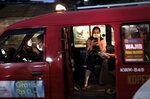 People wear masks as a precaution against coronavirus outbreak as they sit inside a public minivan locally known as 'angkot' in Jakarta, Indonesia, Thursday, Dec. 3, 2020. (AP Photo/Dita Alangkara)