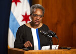 FILE - In this May 31, 2019 file photo, Mayor Lori Lightfoot holds a press conference at City Hall in Chicago. Teachers in Chicago, the nation's third-largest school district, are inching closer to a strike that could take place as early as next month. After rejecting the district's latest offer, Chicago educators are negotiating issues including pay, staffing shortages and class sizes. The labor dispute is one of Mayor Lori Lightfoot's first major tests after taking office this year. (Ashlee Rezin/Chicago Sun-Times via AP File)