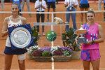 Romania's Simona Halep, right, poses with runner-up Czech Republic's Karolina Pliskova after winning their final match at the Italian Open tennis tournament, in Rome, Monday, Sept. 21, 2020. (Alfredo Falcone/LaPresse via AP)