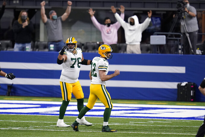 Green Bay Packers quarterback Aaron Rodgers (12) celebrates after a touchdown pass during the first half of an NFL football game against the Indianapolis Colts, Sunday, Nov. 22, 2020, in Indianapolis. (AP Photo/Michael Conroy)