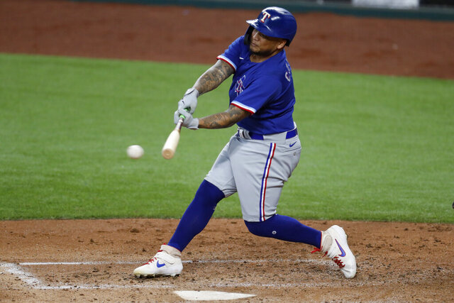 Texas Rangers' Willie Calhoun connects for a hit during an intrasquad practice baseball game at Globe Life Field in Arlington, Texas, Monday, July 6, 2020. (AP Photo/Tony Gutierrez)