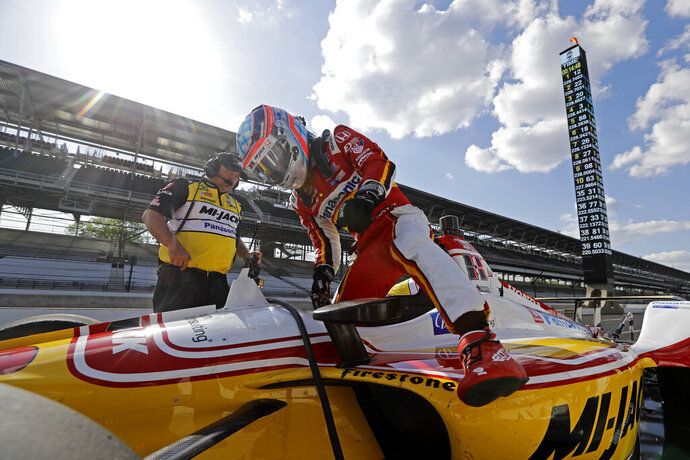 Takuma Sato, of Japan, climbs out of his car during practice for the Indianapolis 500 IndyCar auto race at Indianapolis Motor Speedway, Tuesday, May 14, 2019 in Indianapolis. (AP Photo/Darron Cummings)