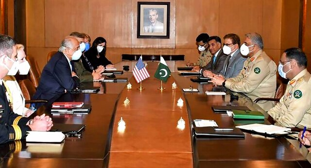 In this photo released Pakistan's military information wing 'Inter Services Public Relations', a U.S. delegation headed by peace envoy for Afghanistan, Zalmay Khalilzad, third left, hold talks with Pakistan's army chief, Gen. Qamar Javed Bajwa, second right, in Rawalpindi, Pakistan, Monday, Sept. 14, 2020. The U.S. peace envoy for Afghanistan was in Pakistan on Monday to express his gratitude for Islamabad's role in helping launch the much-awaited negotiations between the Taliban and Afghan representatives, the Pakistani military said. (Inter Services Public Relations via AP)