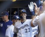 Milwaukee Brewers' Christian Yelich is congratulated after hitting a home run during the sixth inning of a baseball game against the San Francisco Giants Sunday, July 14, 2019, in Milwaukee. (AP Photo/Morry Gash)