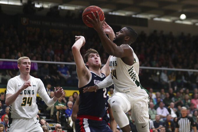 San Francisco guard Charles Minlend (14) shoots against Gonzaga forward Drew Timme (2) during the first half of an NCAA college basketball game in San Francisco, Saturday, Feb. 1, 2020. (AP Photo/Jed Jacobsohn)