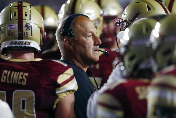 Boston College head coach Steve Addazio stands with his team during a timeout in the first half of an NCAA college football game against Kansas in Boston, Friday, Sept. 13, 2019. (AP Photo/Michael Dwyer)