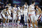 Gonzaga players celebrate as they lead Pepperdine with seconds left in the second half of an NCAA semifinal college basketball game at the West Coast Conference tournament, Monday, March 11, 2019, in Las Vegas. (AP Photo/John Locher)