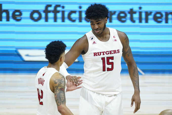 Rutgers' Myles Johnson (15) talks with Jacob Young (42) during the second half of an NCAA college basketball game against Indiana at the Big Ten Conference tournament, Thursday, March 11, 2021, in Indianapolis. Rutgers won 61-50. (AP Photo/Darron Cummings)