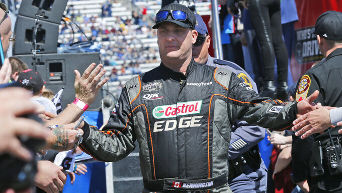 NASCAR Cup Series driver DJ Kennington (77) greets fans during driver introductions prior to the NASCAR Cup Series auto race at the Martinsville Speedway in Martinsville, Va., Sunday, March 24, 2019. (AP Photo/Steve Helber)